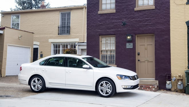 The 2014 Volkswagen Passat SEL was equipped with a turbocharged 1.8-liter four-cylinder engine that generates 170 horsepower and makes up to 34 mpg on highways.