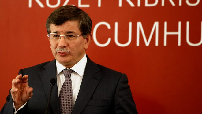 Turkey's Foreign Minister Ahmet Davutoglu speaks to reporters during a press conference after talks with Turkish Cypriot leader Dervis Eroglu, in the breakaway Turkish Cypriot north of ethnically split Cyprus on May 17.