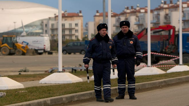 """Russian police patrol near accommodation sites and venues in the Olympic Park in Adler near Sochi, December 31, 2013. President Vladimir Putin on Tuesday vowed to annihilate """"terrorists"""" following two deadly bomb attacks in less than 24 hours in the southern Russian city of Volgograd that raised security fears ahead of the Winter Olympics."""