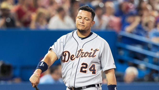 Detroit Tigers' Miguel Cabrera walks back to the dugout after being stranded at third base in the sixth inning of a baseball game against the Toronto Blue Jays in Toronto, Friday July 8, 2016.