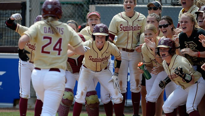 Florida State awaits infielder Victoria Daddis (24) to round the bases after her home run against  NC State during the ACC Softball Semifinals in Blacksburg, Va., May 8, 2015.