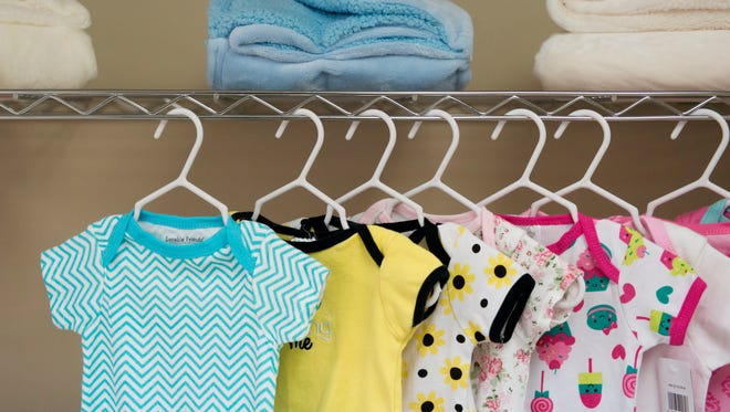 Baby clothes occupy a shelf at Catholic Charities of East Tennessee's Pregnancy Help Center in Newcomb, Tenn.