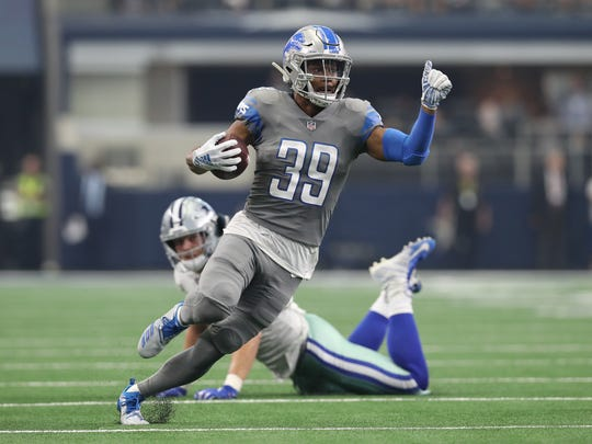 Sep 30, 2018; Arlington, TX, USA; Detroit Lions cornerback Jamal Agnew (39) runs with the ball on a reverse in the second quarter against the Dallas Cowboys at AT&T Stadium. Mandatory Credit: Matthew Emmons-USA TODAY Sports