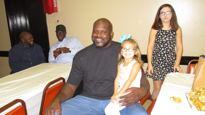 Shaquille O'Neal visits with friends in Lafayette at a party for Lafayette City Marshal, Brian Pope.