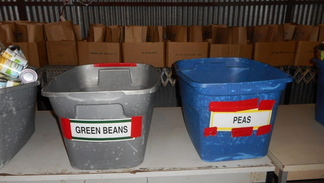 Empty donation bins are pictured at the FoodNet Food Bank warehouse in Lafayette.