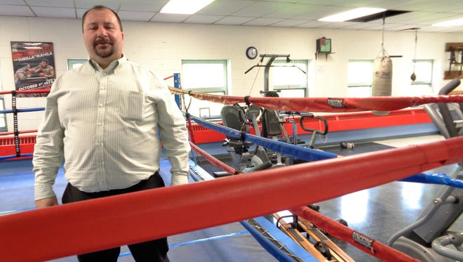 Chuck Hammond shows off the boxing ring inside the Boys and Girls Club of Western Broome in Endicott. Hammond cleans boxing equipment as part of his volunteer service for the club.