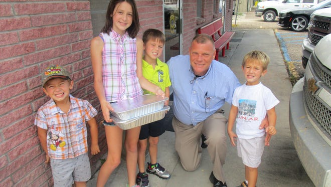 """Khristian Tolar, Harley Daw, Dakota Daw and Kullen Tolar present Duson Police Chief Kip Judice with cupcakes they made to say """"thank you for protecting us."""" Hailey Daw said she made the cupcakes for police because they do """"such a good service."""""""