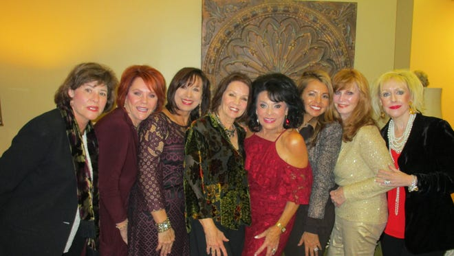 The ASO Women's League held its annual Christmas party at the home of Sharon Moss on Dec.7
