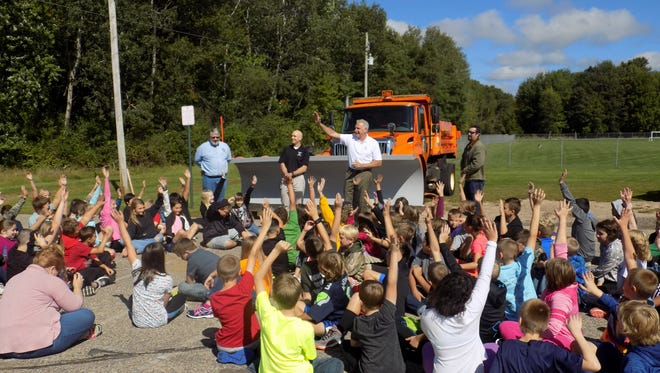 City officials introduce the Paint the Plow project Sept. 8 to students at Madison Elementary School in Stevens Point.