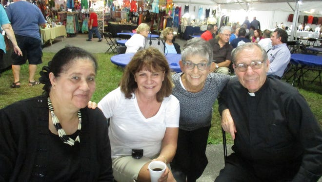 Enjoying the festival are, from left, Saadia Tsaftarides, Katherine Coury, Barbara Nickas, and Father Constantine Xanthakis.