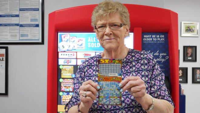 Florine Tripp of Springfield with her winning Missouri Lottery ticket.