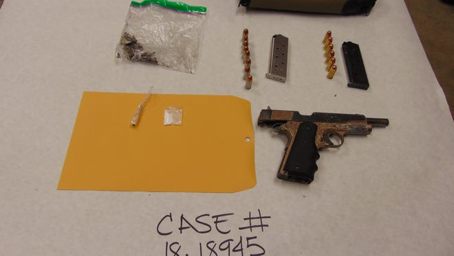 Officers found drugs and weapons after stopping three people early Saturday shortly after midnight.