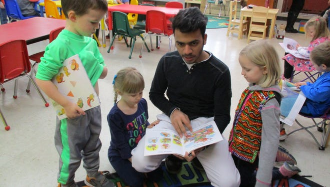 Sandesh, from Mumbai, India, visits with 4-year-old kindergarten students at St. John Lutheran School in Easton.