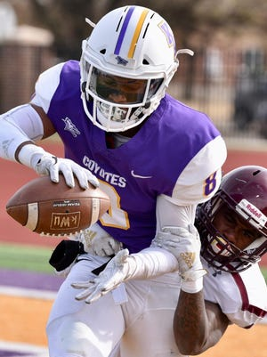 Kansas Wesleyan wide receiver Stevie Williams catches a touchdown pass against Bethel last season. Williams and the Coyotes will begin preseason practice on Saturday.