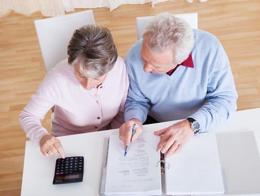 Senior Couple Calculating Budget