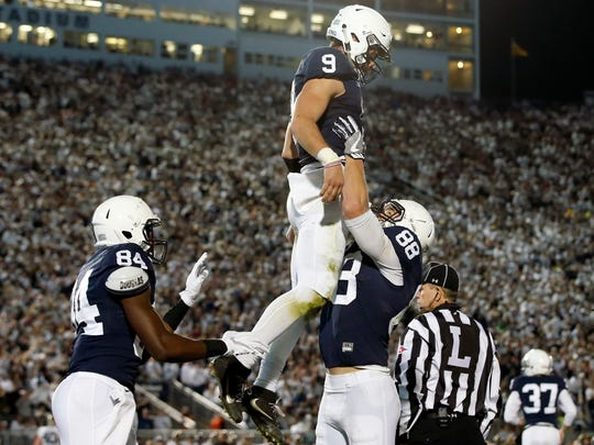 Trace McSorley won over his teammates from his  first appearance in January's TaxSlayer Bowl. Now, he's the undeniable leader. Here, tight end Mike Gesicki (88) celebrates after McSorley (9) ran for a score against Iowa.