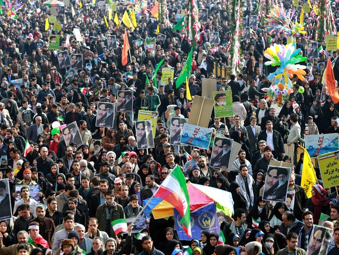 Iranians chant slogans during an annual rally, on Feb. 11, commemorating the anniversary of the 1979 Islamic revolution in Tehran.