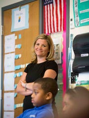 Kuumba Academy's school leader, Sally Maldonado, observes Kelly Hepburn's third-grade class. Kuumba Academy is one of the charter schools implementing a new teacher evaluation system that involves less paperwork and more one-on-one observations and mentoring.