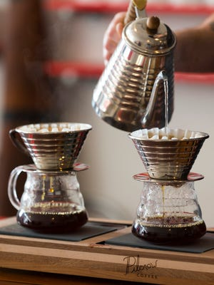 Barista Sam Brown makes coffee by the cup at Pilcrow, 1739 N. King Drive.