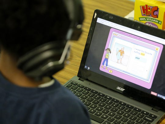A first grade student works on a computer spelling assignment during class at St. Joseph Catholic School in the West End neighborhood of Cincinnati on Tuesday, Jan. 19, 2016. St. Joseph is currently implementing the blended learning method in its school, having students split time between traditional instruction and computer programs.
