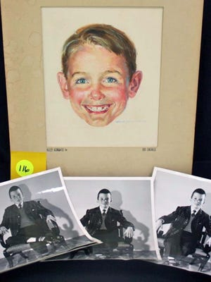 This photo provided by Brookline Auction Gallery of Brookline, N.H., April 18, 2014, shows a watercolor by Robert Childress and photos of the model used to paint it. The portrait is of Dick of the Dick and Jane series of books that helped teach generations of children to read.