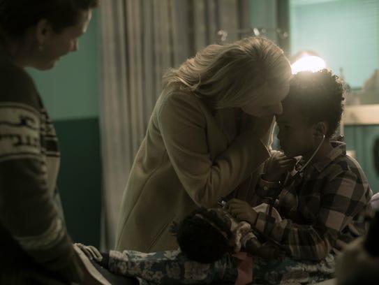 June (Elisabeth Moss) gets her daughter Hannah (Jordana