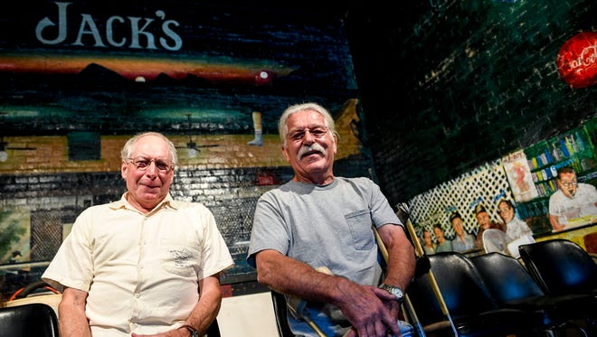 """Robert """"Hawk"""" Miller, left, and Jerry Crouch, right, both who have attended the bar for over five decades, sit at stools in the back corner for a portrait at Jack's Pool Room in Paris, Tenn., Wednesday, July 25, 2018."""