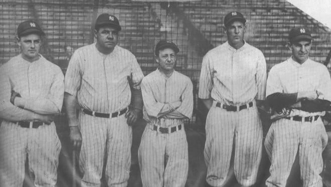 New York Yankees manager Miller Huggins, center, stands with four of his players: Waite Hoyt, from left, Babe Ruth, Bob Meusel and Bob Shawkey. Huggins, a Cincinnati native, won three World Series in 12 seasons as Yankees skipper.