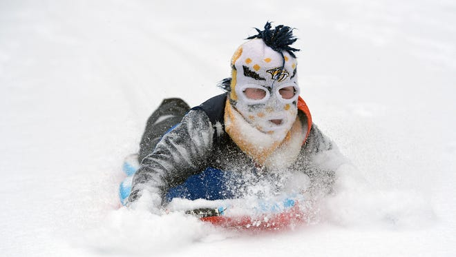 Fisher Bearden,7, sleds down a hill at Radnor Lake State Park in Nashville on Tuesday,  Jan. 16, 2018.