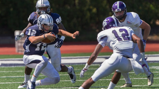 Monmouth University quarterback Cody Williams looks for running room during the 2015 season opening versus Holy Cross. Monmouth will open this season against Leigh on Sept. 3.