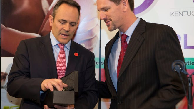 Kentucky Baptist Convention Executive Director Paul Chitwood, right, presents Gov. Matt Bevin the Guardian of Life Award at the Capitol on Wednesday, Feb. 8, 2017.
