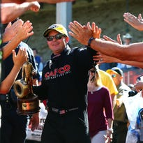 NHRA top fuel driver Steve Torrence celebrates after winning the Mile High Nationals at Bandimere Speedway.