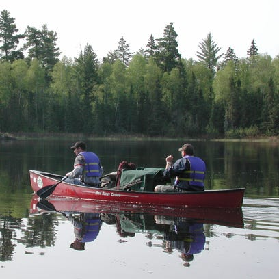 Boy Scout Troop 358 of Shawnee Mission, Kansas, start their eight-day trip on Burntside Lake in the Boundary Waters Canoe Area Wilderness west of Ely.