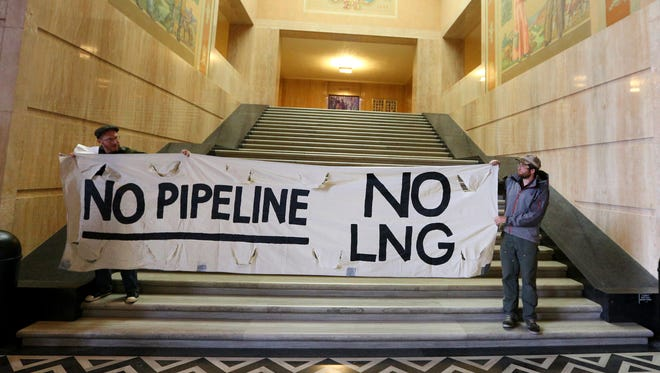 Protesters from Raging Grannies of Oregon along with Southern Oregon Rising Tide, 350.org Eugene and Cascade Forest Defenders protest the Jordan Cove Liquefied Natural Gas export facility and Pacific Connector Gas Pipeline inside the Oregon Capitol, Monday, October 19, 2015, in Salem, Ore.