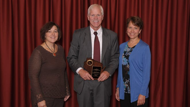 Kennedy Elementary School teachers Kari Worzella, left, and Sue Kollross, right, accept the Wisconsin Title I School of Recognition award from Deputy State Superintendent Mike Thompson.