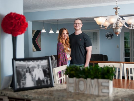 Amanda and Evan Longmore gather in their Marlton home.