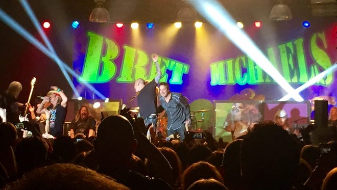 "Bret Michaels, left, invited the guys from Annex, who opened both of his Green Bay Distillery shows last week, to join him on KISS cover ""Rock and Roll All Nite"" to close out the Nov. 3 show."