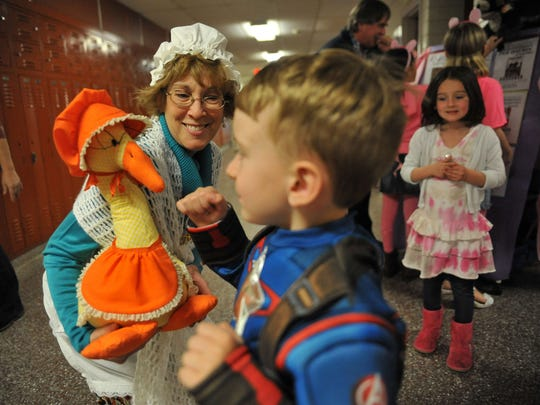 School librarian Judy Bonato, as Mother Goose, talks with 4-year-old Ryan McLoone of Hampton, Va., during Rieck Avenue Elementary's Adventures in Learning event Wednesday.