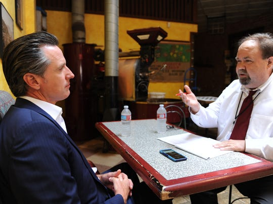 Lieutenant Governor Gavin Newsom and The Californian's Jeff Mitchell on Wednesday at the Cherry Bean Coffee House in Oldtown Salinas.