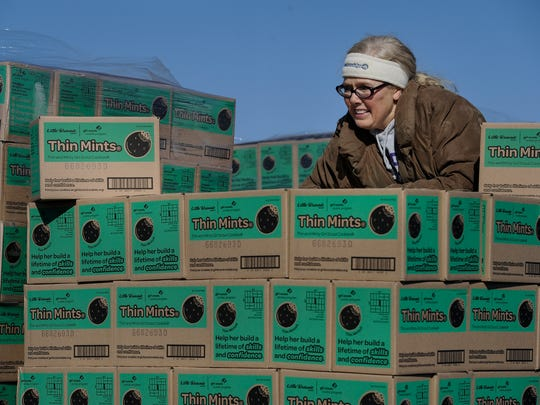 Melanie Terry sorts Thin Mints as she helps distribute Girl Scouts cookies at Nissan Stadium Feb. 3, 2017. The Girl Scouts of Middle Tennessee will distribute over 75,000 cases of cookies to 750 different Girl Scout Troops over two days.