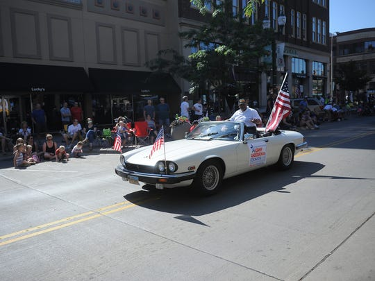 Mayoral candidate Kenny Anderson, Jr. campaigns for the 2018 race during the Fourth of July parade in downtown Sioux Falls on July 4, 2017.