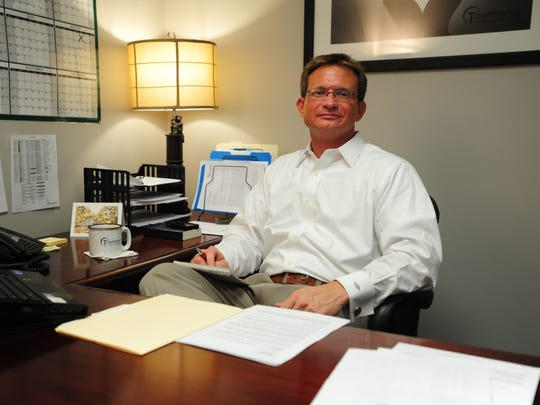 Michael Handley is seen in his Lafayette office in 2012.
