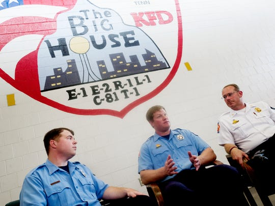 AJ. Spoone, from left, Jordan Adcock and Assistant Chief Mark Wilbanks speak Sept. 27, 2017, at the downtown Knoxville Fire Station.