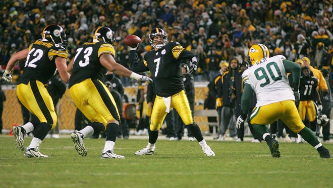 Steelers quarterback Ben Roethlisberger looks to pass during a December 2009 game against the Packers.