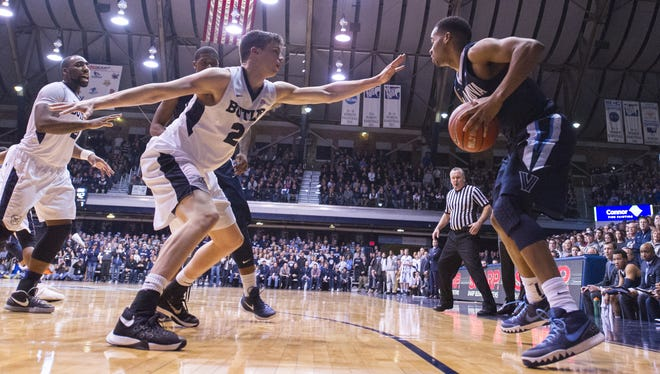 Butler guard Kellen Dunham (24), left, defends Villanova guard Phil Booth (5) during the second half of an NCAA college basketball game, Sunday, Jan. 10, 2016, at Hinkle Fieldhouse. Villanova won 60-55.