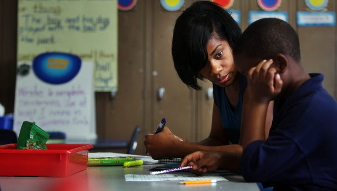 Kemba Edwards (with a student in a 2013 file photo taken at Westhaven Success Academy) will head the Teach Plus effort to better align its work with Shelby County Schools.