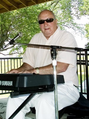 Joe Cavallaro plays keyboards as he and his dixieland band perform  at Brand Park in Elmira.