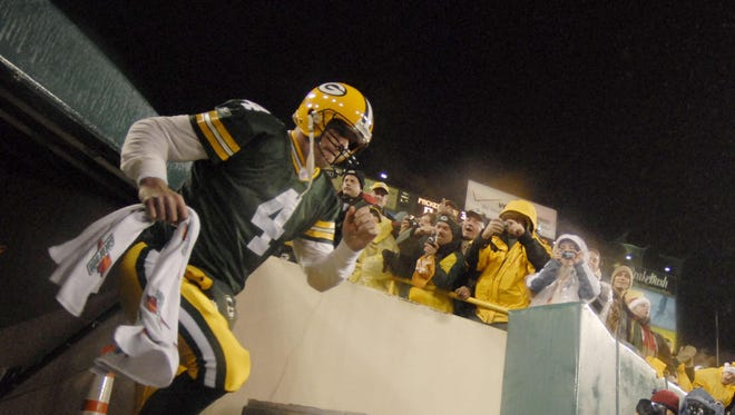 Brett Favre runs onto the field before a 2006 game against the Minnesota Vikings at Lambeau Field.