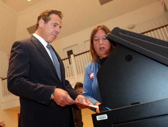 Gov. Andrew Cuomo casts his vote at the Mount Kisco