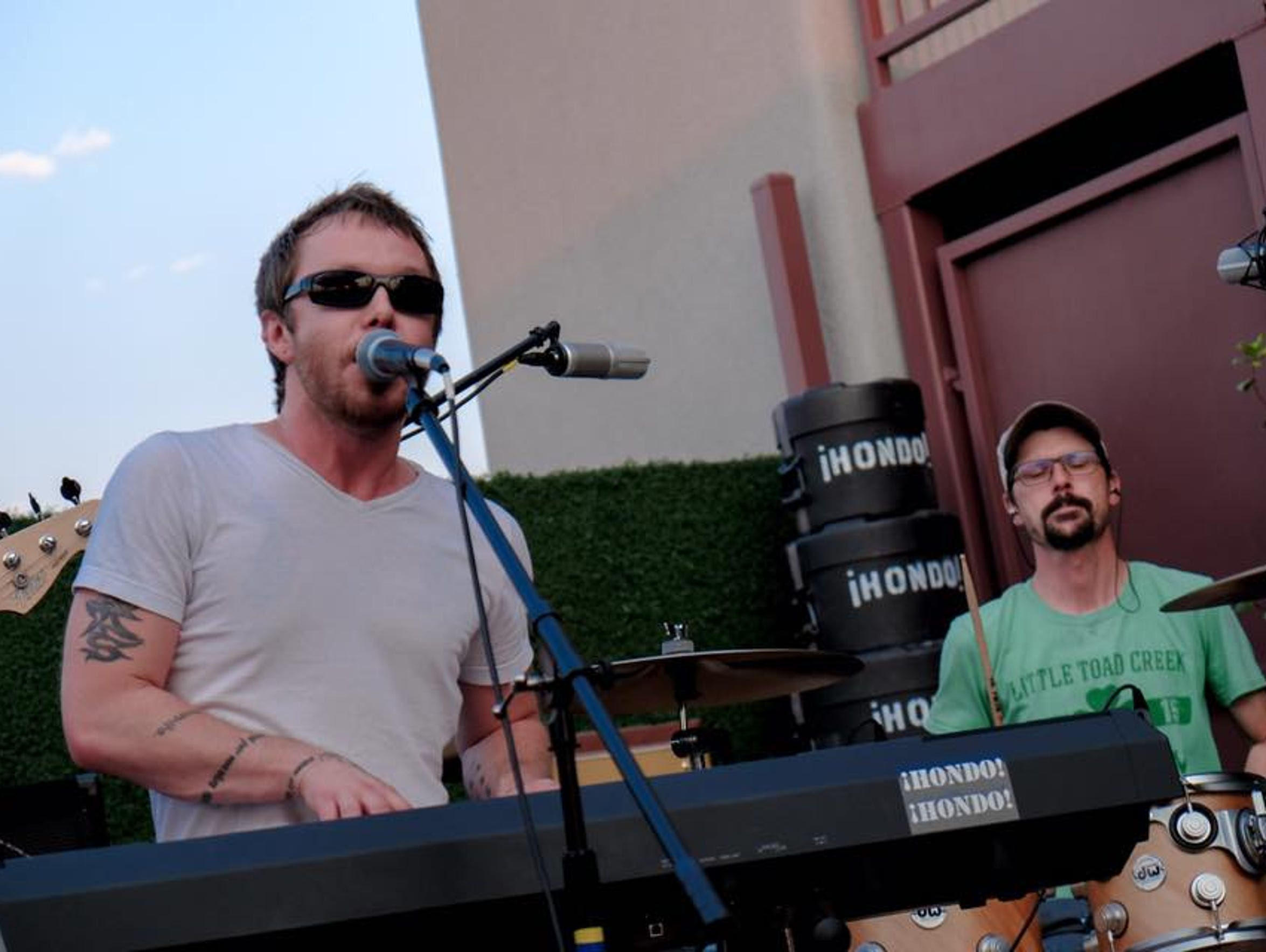 From left to right, ¡HONDO! ¡HONDO! band members Alex Hallwyler on keyboard and Matt Swanson on drums.